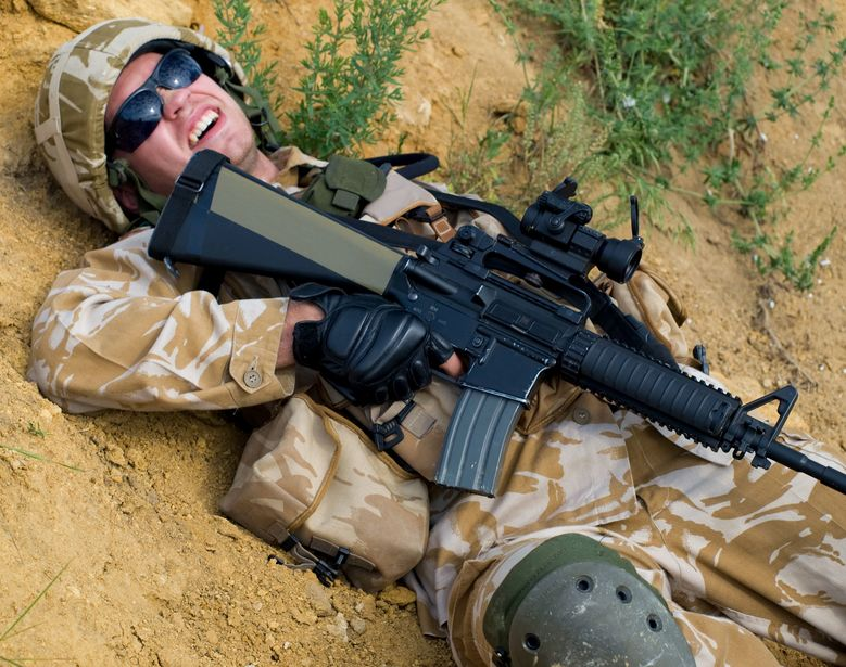 5183125 - british soldier in desert uniform lying wounded